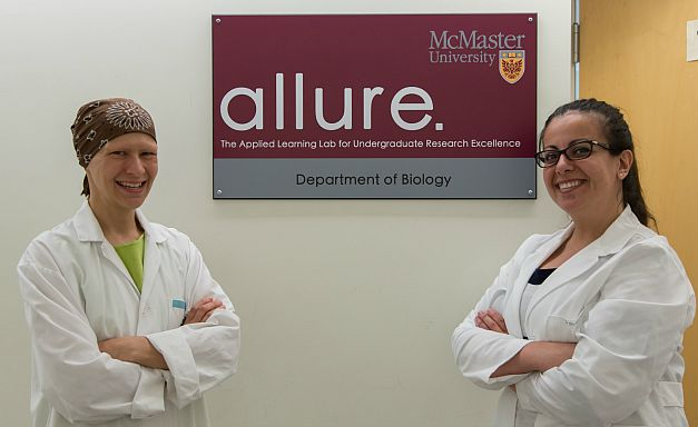 Kim Dej and Rosa da Silva posed in front ot he ALLURE lab in the Department of Biology