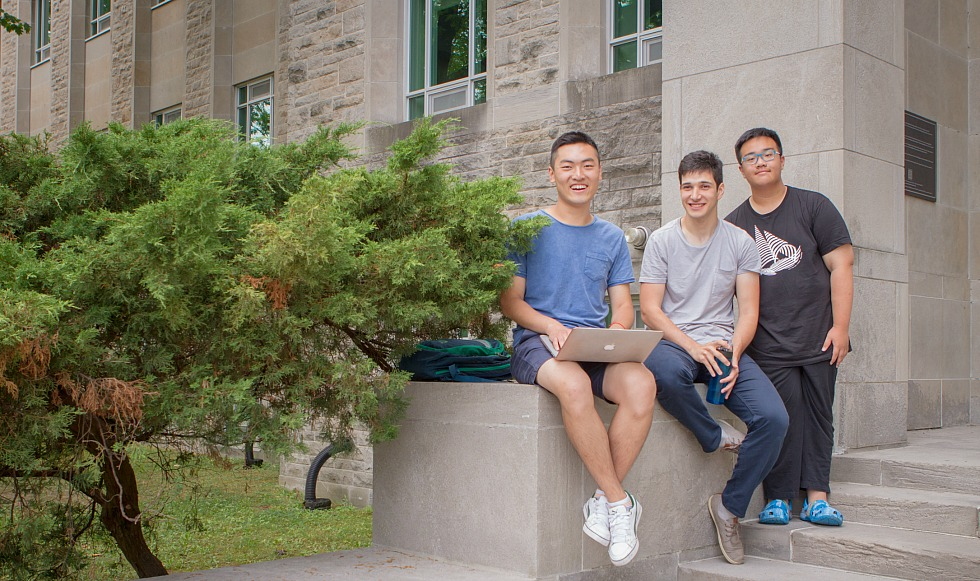 (Left to right) SummerESL@Mac volunteer David Sun, McMaster student and SummerESL@Mac Program Assistant Yahya Ikbal Ayadin, and SummerESL@Mac student Edward Sun take a break from the English language training program, which Edward Sun says has been a 'wonderful experience.'