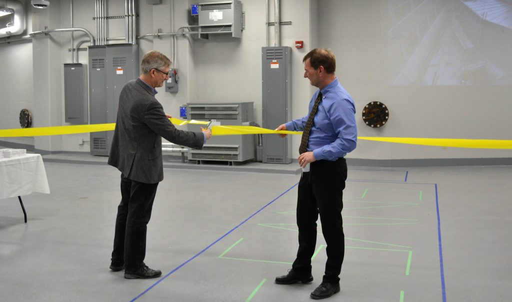 Bruce Gaulin, director of the Brockhouse Institute for Materials Research, left, and Chris Heysel, director of nuclear operations, cut the ribbon to celebrate the completion of the SANS —small angle neutron scattering —guide hall in the Nuclear Research Building.