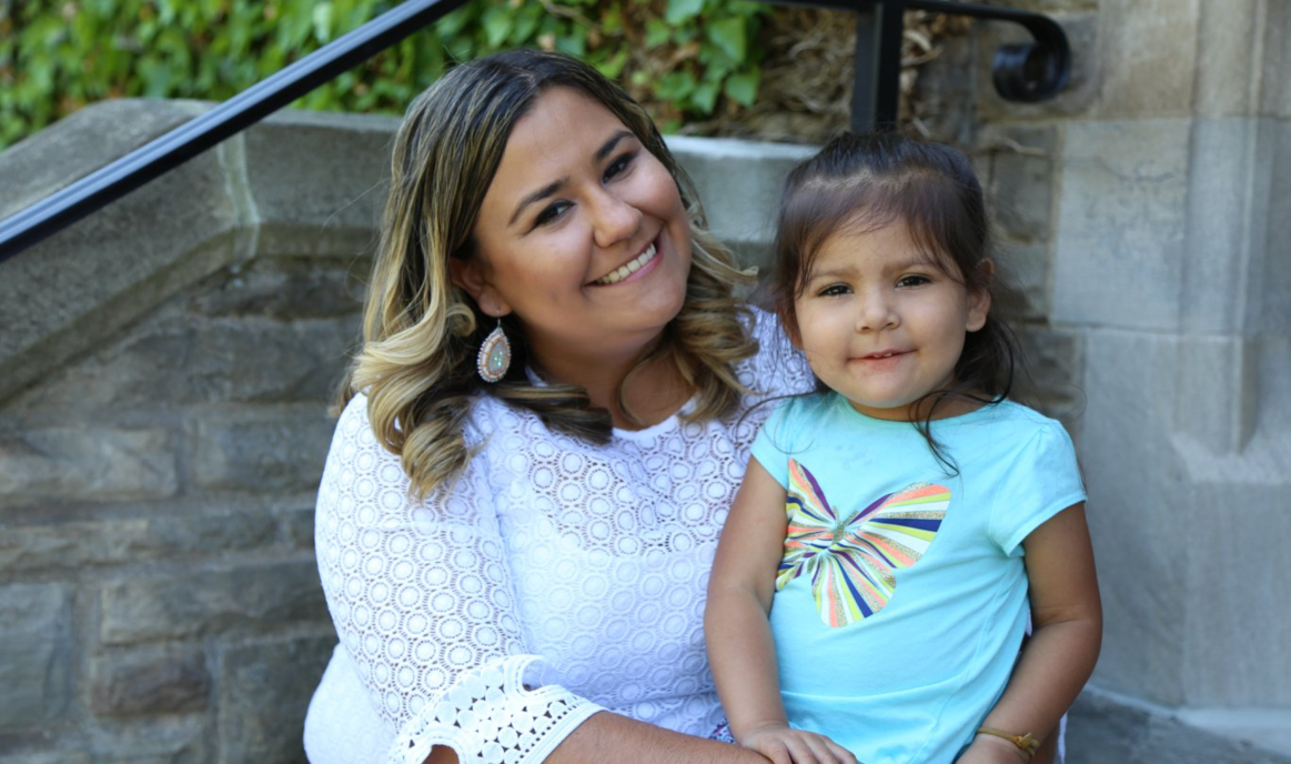 Katelyn Knott and her three-year-old daughter, Iris, share a smile on McMaster University campus ahead of Katelyn's graduation with an Honours degree in anthropology and Indigenous Studies.