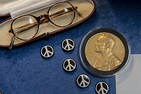 tems from the Russell Archives including his glasses, his Nobel medal, and buttons of the iconic peace sign – the symbol created for the Campaign for Nuclear Disarmament in which Russell was a central figure