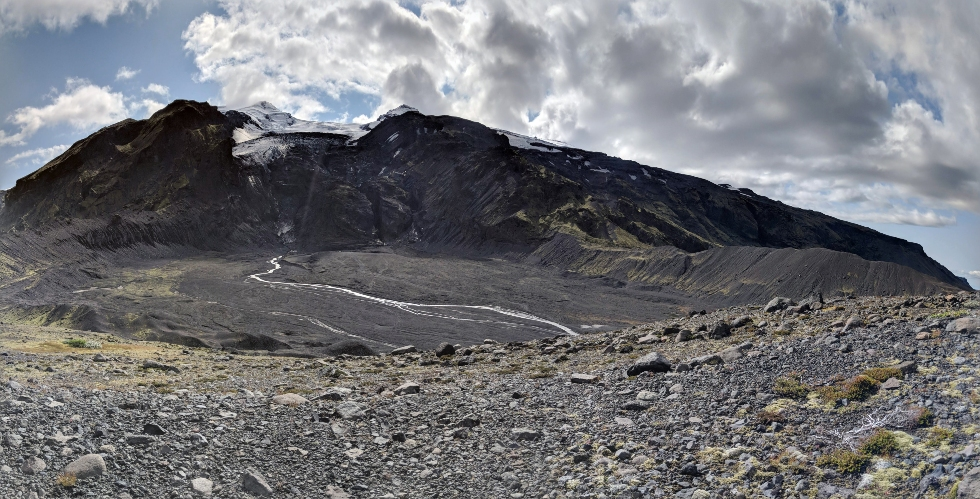 IMAGE CAPTION: This is Gigjökull glacier (the top centre of the picture). Before 2010 a glacial lake rested on the plain in front of the glacier; due to the famous 2010 volcanic eruption of Eyjafjallajökull, a flash flood (Jökulhlaup) was created and what you see in front of the picture (a river plain with rivers is all that remains).