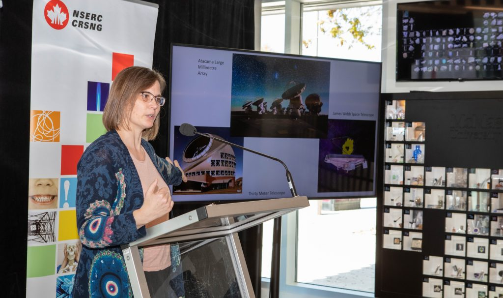 Astronomy professor Allison Sills explains her work with a photo presentation at the announcement of $588 million in new NSERC Discovery Grants.