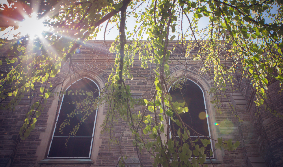 A view of McMaster's University Hall in sunlight
