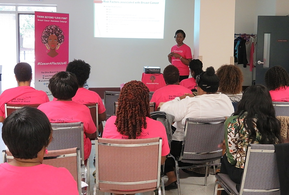 McMaster researcher Juliet Daniel's former trainee, Dr. Blessing Bassey-Archibong – now a McMaster postdoctoral student – gives a breast cancer awareness presentation at the inaugural Think Beyond Love Pink workshop in October 2016.