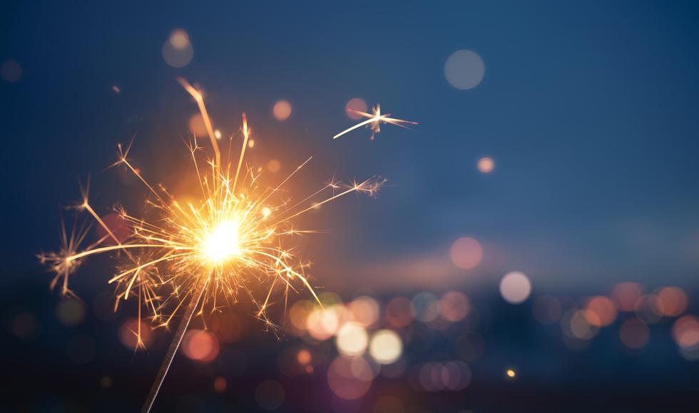 A sparkler against a dark sky